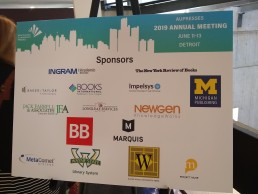 Sponsors board at AUPresses 2019 showing sponsor logos including for Newgen KnowledgeWorks